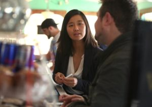 Photo by Pat Greenhouse/Boston Globe Staff. Michelle Wu speaks with community members during a campaign event at Victoria's Diner November 2015.